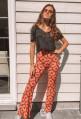 Pantalon HERMINE patte d'eph rouge à motifs jaunes
